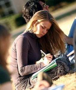A college girl studying outside