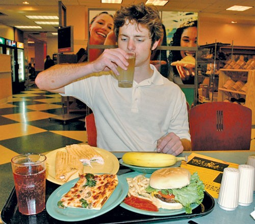 Student Eating at Cafeteria